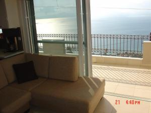 Amazing 2-bed apartment in spectacular villa with stunning sea views, Ferienhäuser  Káto Sélitsa - big - 26