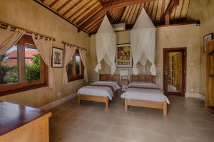 Three Monkeys Villas, Комплексы для отдыха с коттеджами/бунгало  Улувату - big - 16