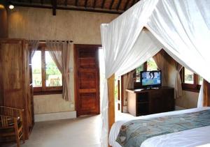 Three Monkeys Villas, Комплексы для отдыха с коттеджами/бунгало  Улувату - big - 17