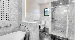 King Suite with Roll - In Shower - Disability Access