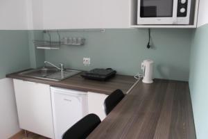 Studio ApartCity, Aparthotels  Braşov - big - 34