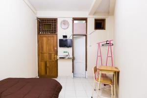 Pele Guesthouse, Penzióny  Bandung - big - 9