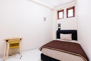 Pele Guesthouse, Penzióny  Bandung - big - 10