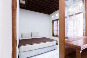 Pele Guesthouse, Penzióny  Bandung - big - 13