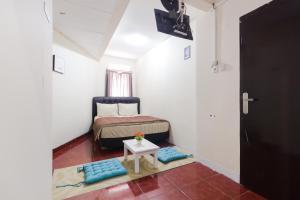 Pele Guesthouse, Penzióny  Bandung - big - 18