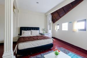 Pele Guesthouse, Penzióny  Bandung - big - 19