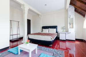 Pele Guesthouse, Penzióny  Bandung - big - 20