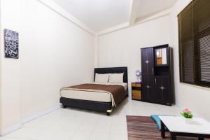 Pele Guesthouse, Penzióny  Bandung - big - 21