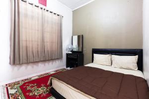Pele Guesthouse, Penzióny  Bandung - big - 27