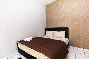 Pele Guesthouse, Penzióny  Bandung - big - 29
