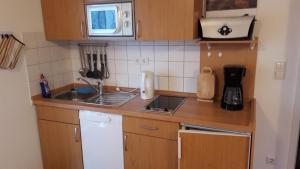 Ferienwohnung 15 in Koserow, Apartmány  Ostseebad Koserow - big - 7