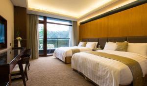 Fuli Hot Spring Resort, Szállodák  Jücsi - big - 37
