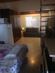 Residencial Cid, Vendégházak  Florianópolis - big - 11