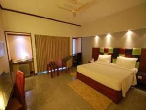 Velan Hotel Greenfields, Hotely  Tiruppūr - big - 4