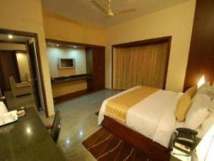 Velan Hotel Greenfields, Hotely  Tiruppūr - big - 9