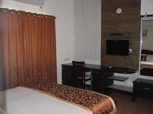 Executive Comfort Guindy, Apartmanok  Csennai - big - 13