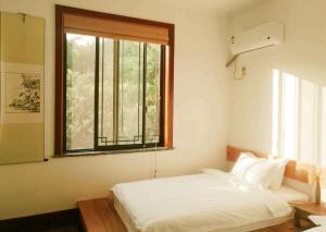 Pure-Land Villa, Privatzimmer  Suzhou - big - 33