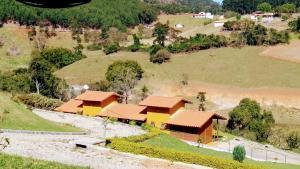 Pousada Chalés Harmonia, Vendégházak  Piracaia - big - 7
