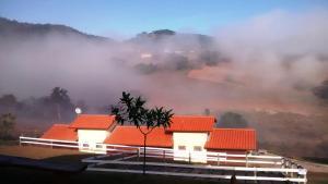 Pousada Chalés Harmonia, Vendégházak  Piracaia - big - 9