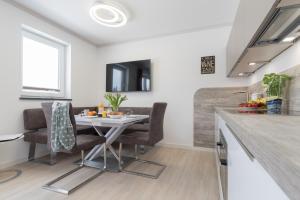 Ferienwohnungen Rosengarten, Apartmány  Börgerende-Rethwisch - big - 250