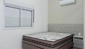 Residencial Aguas Azuis 2 Suites, Апартаменты  Бомбиньяс - big - 3
