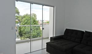 Residencial Aguas Azuis 2 Suites, Апартаменты  Бомбиньяс - big - 9