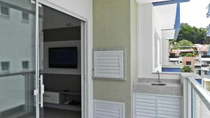 Residencial Aguas Azuis 2 Suites, Апартаменты  Бомбиньяс - big - 23