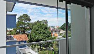 Residencial Aguas Azuis 2 Suites, Апартаменты  Бомбиньяс - big - 24