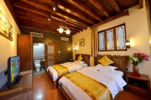 Yujian Zunxiang Guest House, Homestays  Lijiang - big - 1