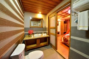 Yujian Zunxiang Guest House, Homestays  Lijiang - big - 10