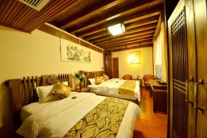 Yujian Zunxiang Guest House, Homestays  Lijiang - big - 9