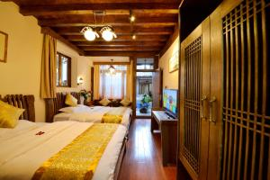Yujian Zunxiang Guest House, Homestays  Lijiang - big - 6