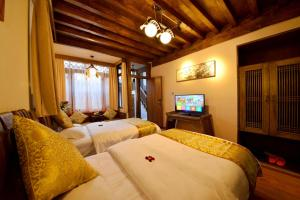 Yujian Zunxiang Guest House, Homestays  Lijiang - big - 29