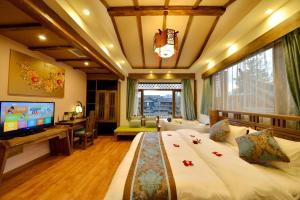 Yujian Zunxiang Guest House, Homestays  Lijiang - big - 36