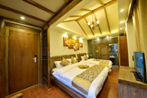 Yujian Zunxiang Guest House, Homestays  Lijiang - big - 37