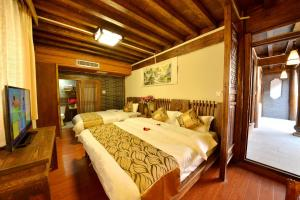 Yujian Zunxiang Guest House, Homestays  Lijiang - big - 43
