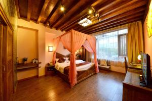 Yujian Zunxiang Guest House, Homestays  Lijiang - big - 46