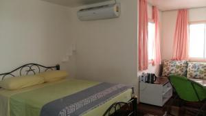 Dvoulůžkový pokoj Deluxe s manželskou postelí a vanou