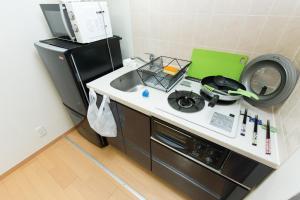 Tokyo Faminect Apartment FN227, Apartmány  Tokio - big - 16