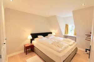 Ulenhof Appartements, Ferienwohnungen  Wenningstedt-Braderup - big - 12