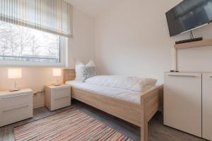 Haus Baltic Cube, Ferienwohnungen  Börgerende-Rethwisch - big - 205