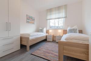 Haus Baltic Cube, Ferienwohnungen  Börgerende-Rethwisch - big - 206