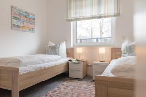 Haus Baltic Cube, Ferienwohnungen  Börgerende-Rethwisch - big - 204