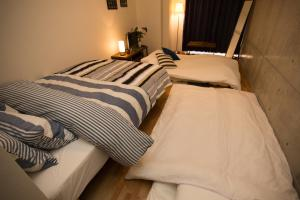 Osaka Faminect Apartment FN427, Apartmanok  Oszaka - big - 14