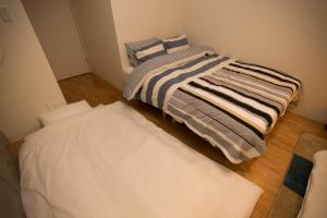 Osaka Faminect Apartment FN427, Apartmanok  Oszaka - big - 13