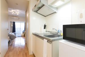 Osaka Faminect Apartment FN427, Apartmanok  Oszaka - big - 2