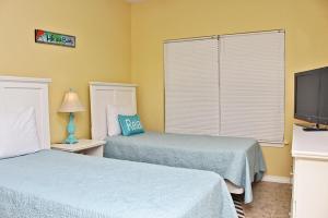 Orange Beach Villas - Beach Retreat Home, Dovolenkové domy  Orange Beach - big - 17