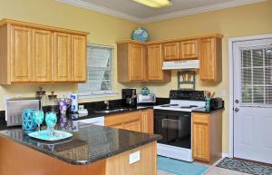 Orange Beach Villas - Beach Retreat Home, Dovolenkové domy  Orange Beach - big - 22