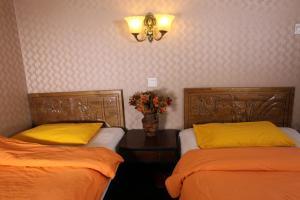 Tweepersoonskamer met 2 Aparte Bedden