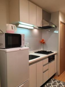 Ikebukuro Sunshine Broad City Inn, Апартаменты  Токио - big - 43